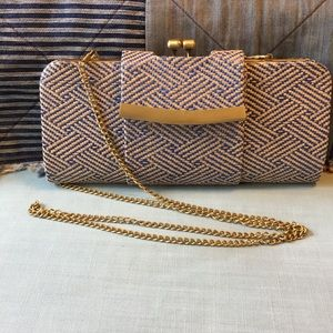 Mystique, straw woven Clutch with bronze details